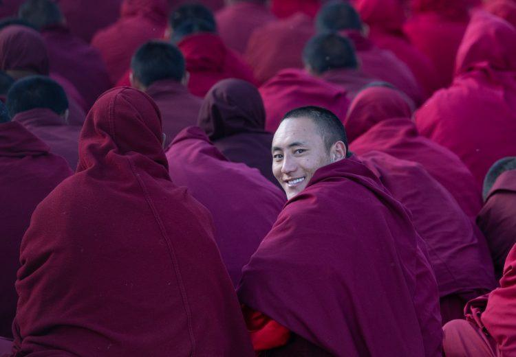 Smiling monks at a prayer session in Sexu or Sershul in remote Sichuan