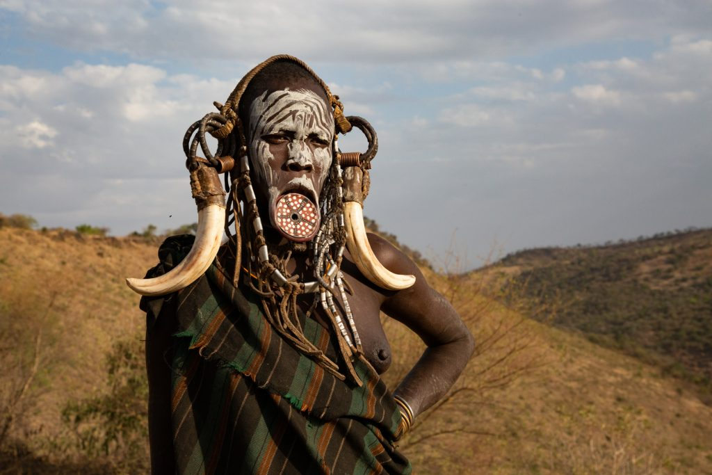 Portrait of a decorated Mursi woman