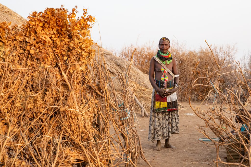 Portrait of a Nyangatom woman at her hut in the central Rift Valley of southern Ethiopia with Wild Images photo tours