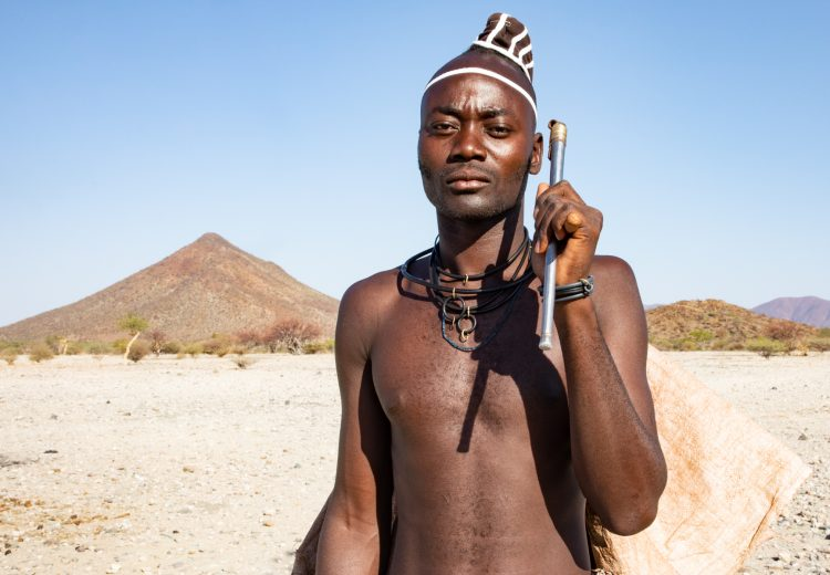 Tribe photography of the Muhimba people in Angola requires exploring the beautiful Yona National Park