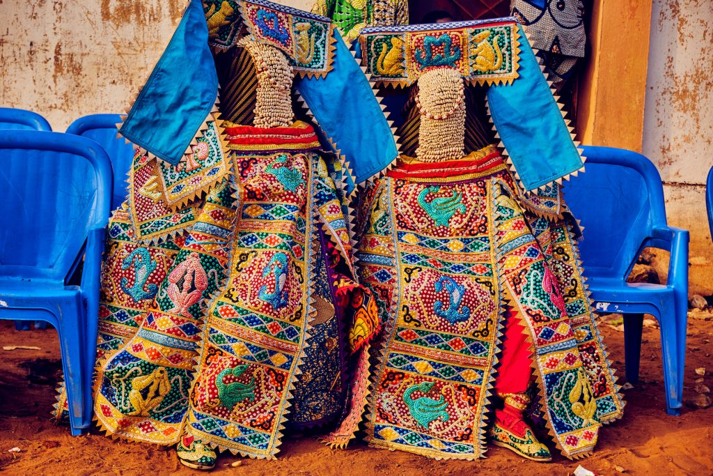 Photographing the masked Egunguns on our Benin photography tour