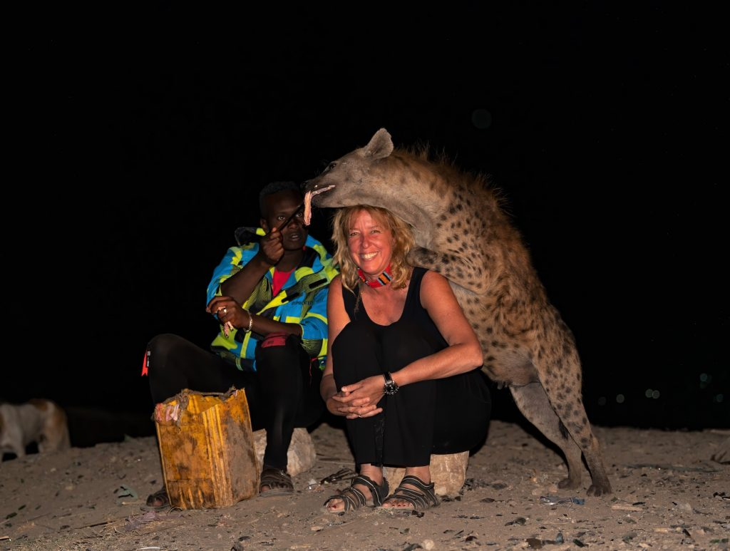 Inger Vandyke and famous Hyena Man of Harar, Abbas with a Spotted Hyaena