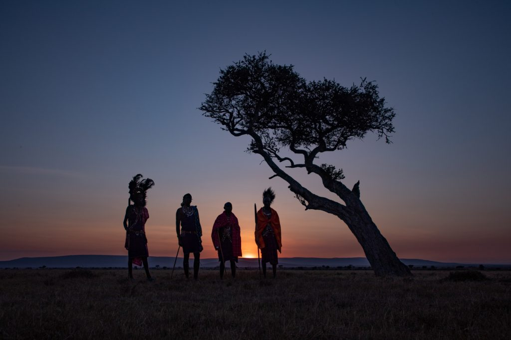 Maasai warriors greet the new day on our Kenya photography tour (image by Inger Vandyke)