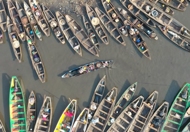 Colourful pirogues dock in Cotonou after Tofinu fishermen bring fish to the local market